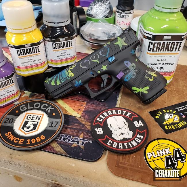 Cerakoted: S.H.O.T,Glock 44,Corvette Yellow H-144,Bright Purple H-217,Zombie Green H-168,Girl Camo,Armor Black H-190,Pistol,Glock,Girly,Sky Blue H-169
