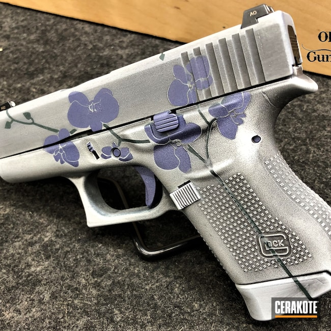 Cerakoted: S.H.O.T,Snow White H-136,Graphite Black H-146,Distressed,Floral,Pistol,Glock,CHARCOAL GREEN H-338,Orchids,CRUSHED ORCHID H-314,Glock 43