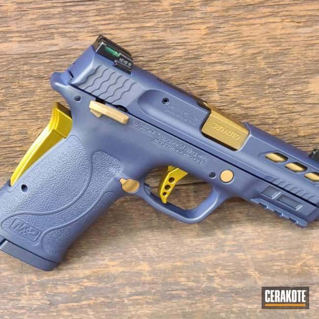 Cerakoted Two Toned Smith & Wesson Handgun In H-315 And H-122