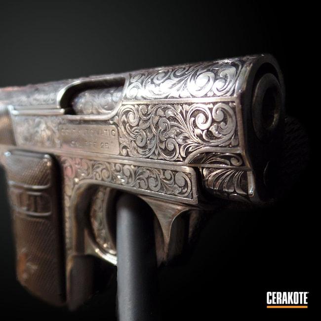 Cerakoted: S.H.O.T,Hand Engraved,25 auto,Engraving Refinish,Armor Black C-192,Antique,Colt,Restoration,Pistol