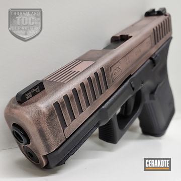 Glock G44 Coated Using Rose Gold And Graphite Black