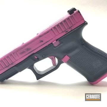 Glock G44 Coated Using Prison Pink And Graphite Black