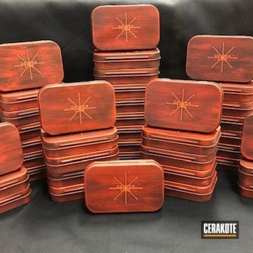 Tin Boxes Cerakoted Using Hunter Orange And Graphite Black