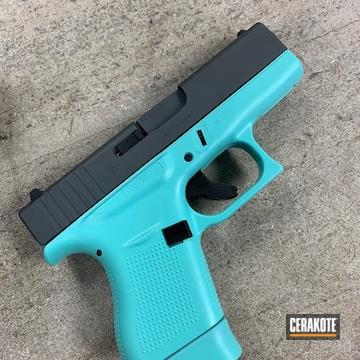 9mm Glock Cerakoted Using Platinum Grey And Robin's Egg Blue