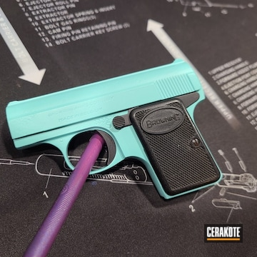 25 Browning Pistol Cerakoted Using Graphite Black And Robin's Egg Blue