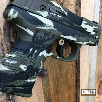 Multicam Taurus Pistol Cerakoted Using Armor Black, Patriot Brown And Sniper Green