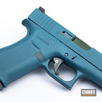 Glock Cerakoted Using Jesse James Eastern Front Green, Jesse James Civil Defense Blue And Jesse James Cold War Grey