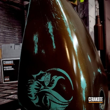Motorcycle Tank Cerakoted Using High Gloss Ceramic Clear, Robin's Egg Blue And Burnt Bronze