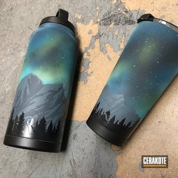Custom Rtic Tumblers Cerakoted Using Blue Raspberry, Bright White And Zombie Green