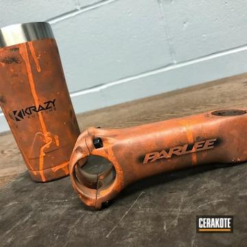 Parlee Bike Component And Tumbler Cerakoted Using Hunter Orange And Graphite Black