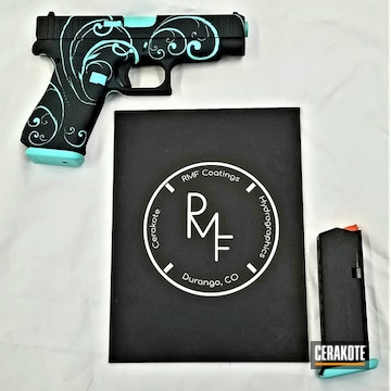 Glock 19 Cerakoted Using Graphite Black And Robin's Egg Blue