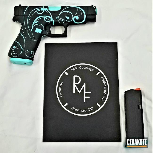 Cerakoted: S.H.O.T,Glock 19,9mm,Robin's Egg Blue H-175,Graphite Black H-146,Swirls