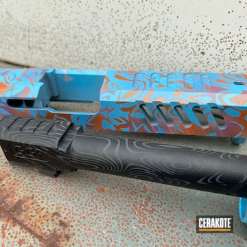 Glock Slide And Barrel Cerakoted Using Ridgeway Blue, Armor Black And Copper Suede