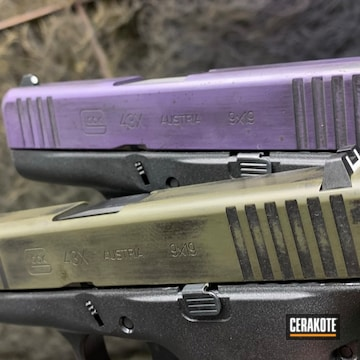 Pair Of Battleworn 43x Glocks Cerakoted Using O.d. Green, Graphite Black And Bright Purple
