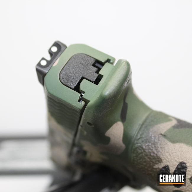Cerakoted: S.H.O.T,M&P,Woodland Camo,MP9,Pistol,M&P 2.0,S&W,Plum Brown H-298,Handgun,9mm,Highland Green H-200,MultiCam,Graphite Black H-146,M&P9,Smith & Wesson,MCMILLAN® TAN H-203