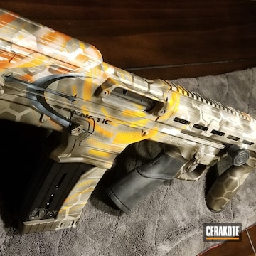 Custom 12 Gauge Shotgun Cerakoted Using Hunter Orange, Vortex® Bronze And Stormtrooper White