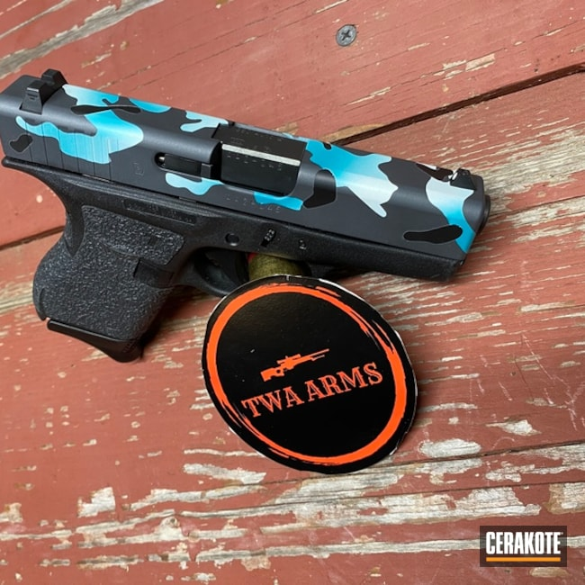 Glock 42 Cerakoted Using Bright White, Sniper Grey And Aztec Teal