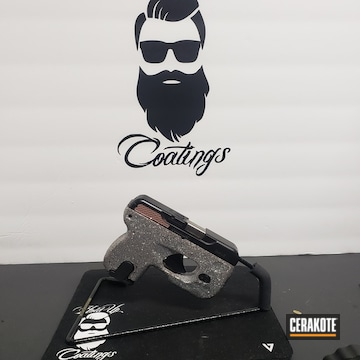 Custom Taurus Pistol Cerakoted Using Rose Gold And Graphite Black
