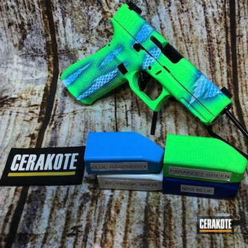 Glock 45 Cerakoted Using Blue Raspberry, Stormtrooper White And Parakeet Green