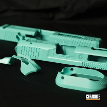 Pistol Slide And Components Cerakoted Using Robin's Egg Blue