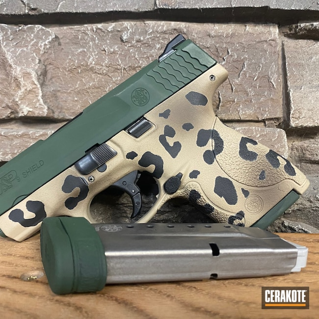 Cerakoted: S.H.O.T,9mm,Leopard Print,Mud Brown H-225,Graphite Black H-146,Desert Sand H-199,Smith & Wesson,Shield,Jesse James Eastern Front Green H-400