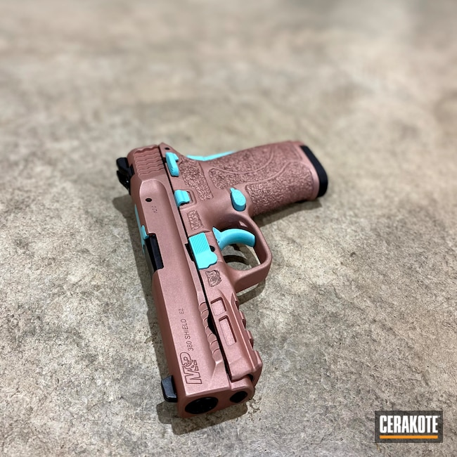 Cerakoted: S.H.O.T,Stippling,Robin's Egg Blue H-175,Smith & Wesson M&P Shield EZ,9mm EZ,Smith & Wesson,Pistol,S&W M&P 9mm,Firearms,M&P Shield EZ,ROSE GOLD H-327