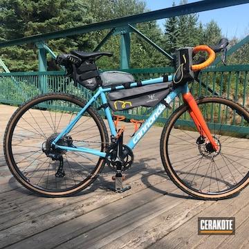 Cannondale Topstone Bicycle Cerakoted Using Hunter Orange, Bright White And Robin's Egg Blue