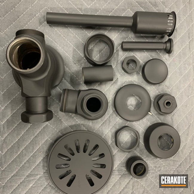 Shower Drain And Urinal Components Cerakoted Using Armor Black