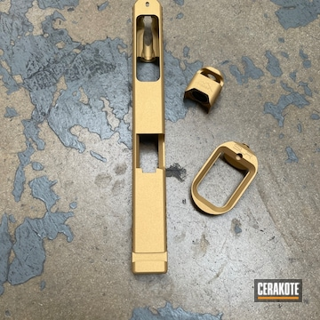 Glock Slide And Components Cerakoted Using Gold