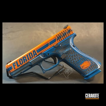 University Of Florida Themed Glock 17 Cerakoted Using Hunter Orange, Sky Blue And Graphite Black