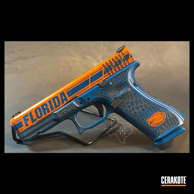 Cerakoted: S.H.O.T,Laser Stippled,Pistol,Glock 17,Laser Engrave,Semi-Auto,9mm,Florida State,Gator,Gator Glock,Graphite Black H-146,Glock,Hunter Orange H-128,University of Florida,Sky Blue H-169