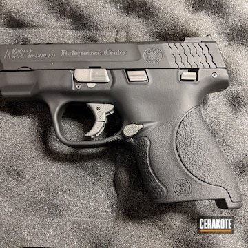 Smith & Wesson M&p Shield Cerakoted Using Savage® Stainless And Graphite Black