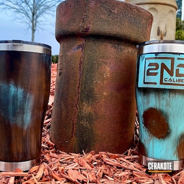Rustic Themed Tumblers Cerakoted Using Crimson, Tequila Sunrise And Jesse James Eastern Front Green