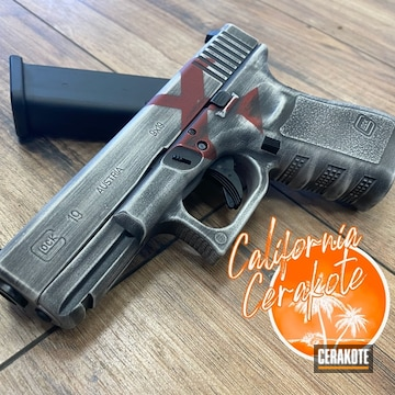 Battleworn Glock 19 Cerakoted Using Crimson, Stormtrooper White And Graphite Black