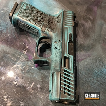 Glock 19 Pistol Cerakoted Using Aztec Teal And Graphite Black
