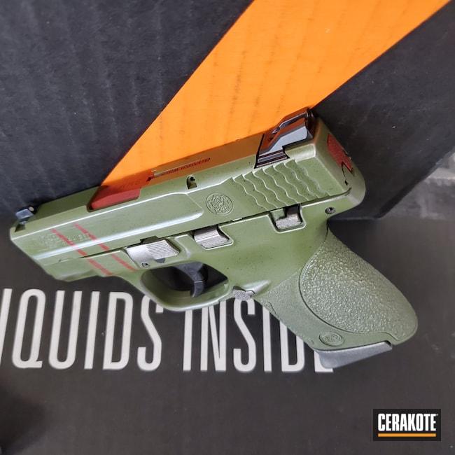Cerakoted: S.H.O.T,MULTICAM® BRIGHT GREEN H-343,Unreal Tournament,Crimson H-221,Pistol,Quake,9mm,Dooms Day,Graphite Black H-146,Smith & Wesson,Titanium H-170,Theme,M&P Shield