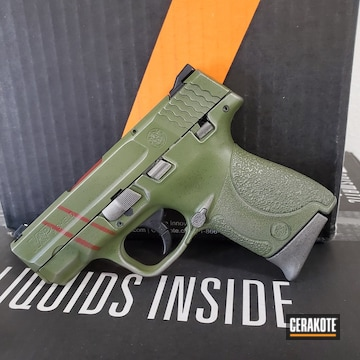 Quake Themed M&p Shield Pistol Cerakoted Using Crimson, Multicam® Bright Green And Titanium