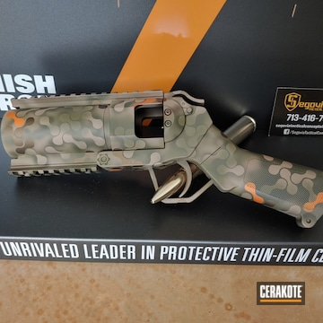 Custom Camo 40mm Airsoft Grenade Launcher Cerakoted Using Midnight Bronze, Tequila Sunrise And Magpul® Fde