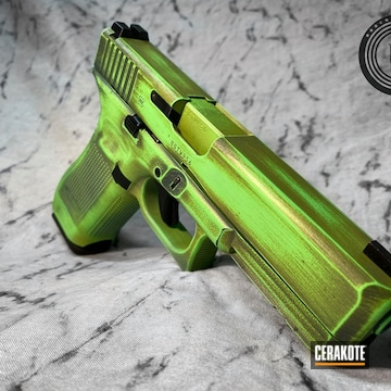 Battleworn Glock 17 Pistol Cerakoted Using Mojito, Parakeet Green And Jesse James Civil Defense Blue