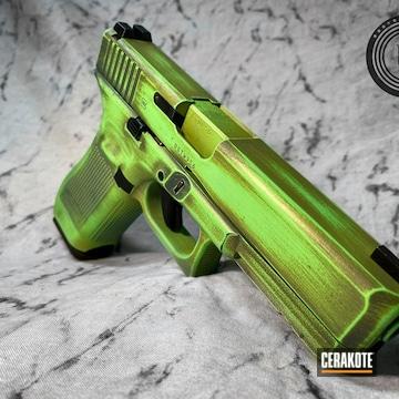 Battleworn Glock 17 Pistol Cerakoted Using Mojito, Parakeet Green And Jesse James Civil Defense Blue