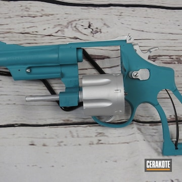 Smith & Wesson Revolver Cerakoted Using Satin Aluminum And Aztec Teal