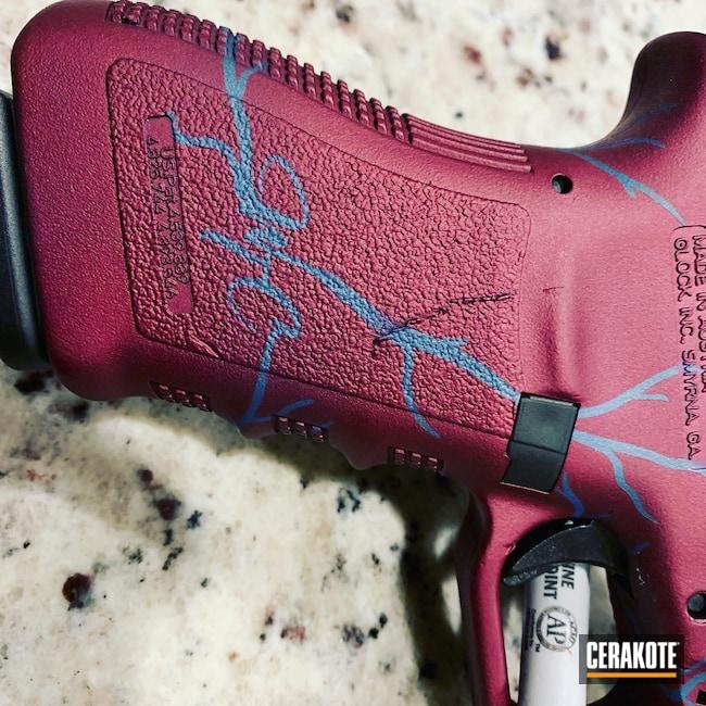 Cerakoted: S.H.O.T,Custom,BLACK CHERRY H-319,Glock,Blue Titanium H-185