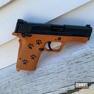 Paw Prints Themed Smith & Wesson Shield Pistol Cerakoted Using Tequila Sunrise And Graphite Black