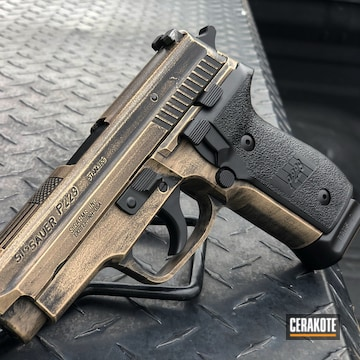 Battleworn Sig Sauer P229 Pistol Cerakoted Using Armor Black And Magpul® Flat Dark Earth