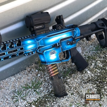 Battleworn Ar Cerakoted Using Socom Blue, Snow White And Sky Blue