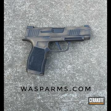 Battleworn Sig Sauer P365 Pistol Cerakoted Using Graphite Black And Burnt Bronze