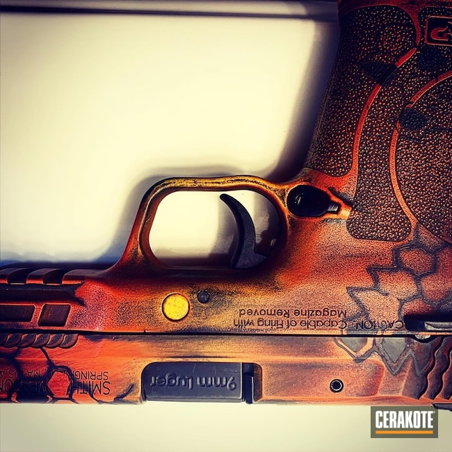 Smith & Wesson M&p Shield Pistol Cerakoted Using Electric Yellow, Terra Cotta And Hi-vis Orange