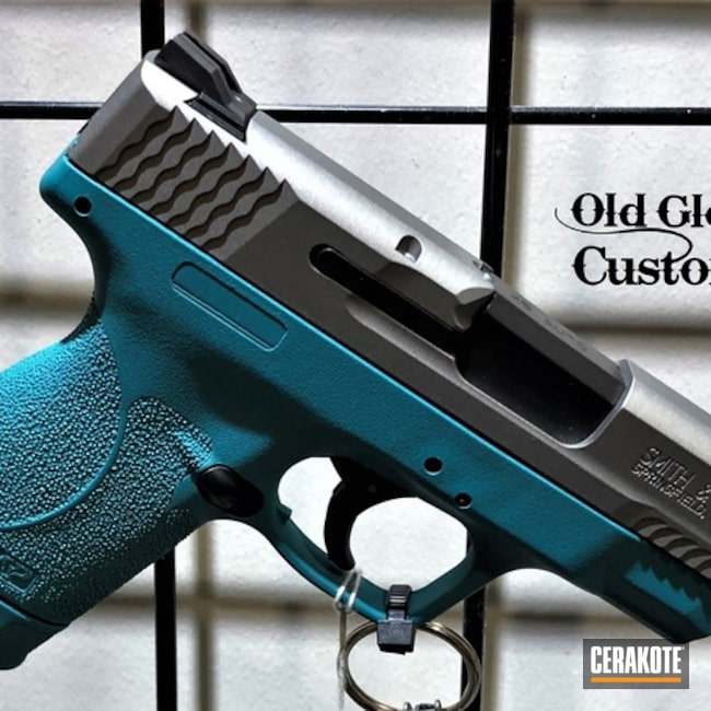 Smith & Wesson M&p Shield Pistol Cerakoted Using Stainless And Aztec Teal