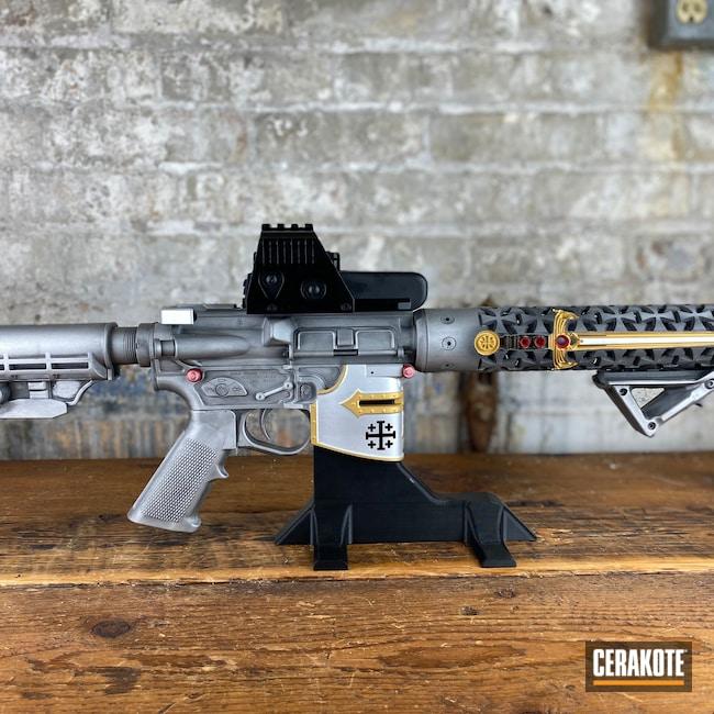 Cerakoted: S.H.O.T,AR,RUBY RED H-306,Firearm,Satin Aluminum H-151,Spikes,Cobalt H-112,Gold H-122,Crusader