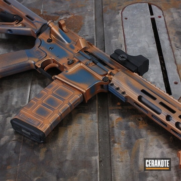 Battleworn Ar-15 Cerakoted Using Copper And Blue Titanium